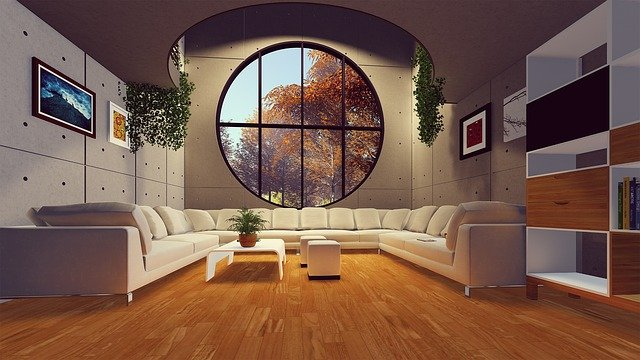 intérieur maison avec canapé et grande ouverture lumineuse